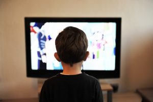 Invisalens - health problems - A child watching too close to the television.